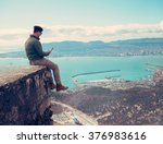 traveler young man sitting with ... | Shutterstock . vector #376983616