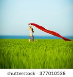 young happy woman in wheat... | Shutterstock . vector #377010538