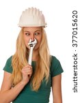 Small photo of Woman with constructor helmet and tools gesturing stuffy nose