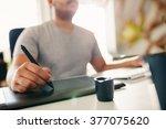hand of male designer working...   Shutterstock . vector #377075620