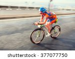 female athlete riding bicycle... | Shutterstock . vector #377077750