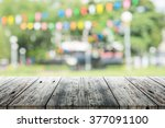 empty wooden table with blurred ... | Shutterstock . vector #377091100