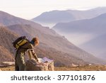 Female Hiker With Backpack...