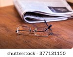 Reading Newspapers  Glasses An...