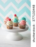 colorful cupcakes on cakestand... | Shutterstock . vector #377133448