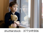 The Little Boy Looks Out The...