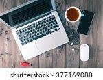 laptop on wooden table | Shutterstock . vector #377169088
