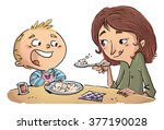 mother feeding her child | Shutterstock . vector #377190028