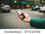 male hand holding modern black... | Shutterstock . vector #377215783