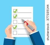 hand filling checklist  mark  ... | Shutterstock .eps vector #377335144