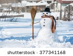 snowman in a hat with a broom... | Shutterstock . vector #377341168