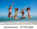 boys and girls jumping on the... | Shutterstock . vector #377351386