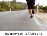 woman's legs running outdoors... | Shutterstock . vector #377358148
