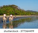 horseback riding in costa rica... | Shutterstock . vector #377364499