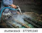 worker is cleaning the machine... | Shutterstock . vector #377391160