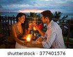 young couple enjoying a... | Shutterstock . vector #377401576