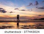 Silhouette Of Couple On Sunset...