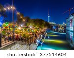 Stock photo people dancing at summer strandbar beach party near spree river at historic museum island with 377514604