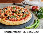 pizza with minced meat tomato... | Shutterstock . vector #377552920