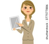 woman in suits tablet | Shutterstock . vector #377577886
