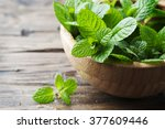 green fresh mint om the wooden... | Shutterstock . vector #377609446