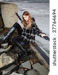 blonde girl near winter river... | Shutterstock . vector #37764694