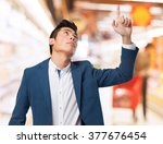 chinese  man pointing up | Shutterstock . vector #377676454