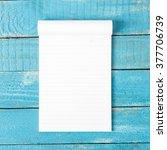 white line paper on blue wooden ... | Shutterstock . vector #377706739