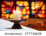 Burning Candle In A Church Wit...