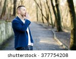 Man Smoking A Cigarette At The...