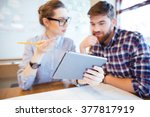 two business people working... | Shutterstock . vector #377817919