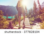hiking man in the mountains | Shutterstock . vector #377828104