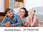 portrait of cheerful parents... | Shutterstock . vector #377920753