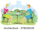 two women sitting in an outdoor ... | Shutterstock .eps vector #378028240