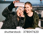 cool fashionable girls taking a ... | Shutterstock . vector #378047620