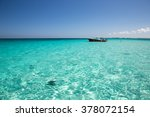 Small photo of Boat in Cayman Island's crystal clear waters.