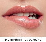 woman lips mouth biting lip  | Shutterstock . vector #378078346