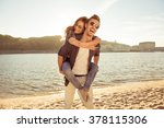 happy young man piggybacking... | Shutterstock . vector #378115306
