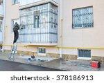 Contractor Installing  Window...