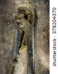 Small photo of alligator wrench on metal background