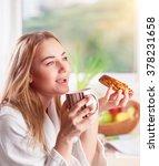 beautiful woman enjoying tasty... | Shutterstock . vector #378231658