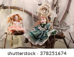 Porcelain Dolls On Swings Phot...
