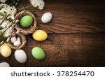 easter eggs on wood background | Shutterstock . vector #378254470