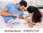 happy young family with baby | Shutterstock . vector #378291724