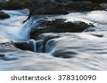 Water Flows Smoothly Over Rocks