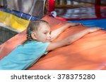 six year girl lies on a soft...   Shutterstock . vector #378375280
