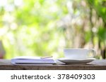 notebook  and cup with pencil... | Shutterstock . vector #378409303
