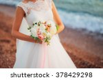 wedding bouquet in hands of the ... | Shutterstock . vector #378429298