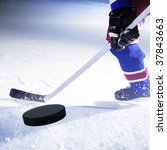 ice hockey player shoots puck - stock photo