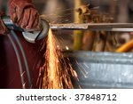 worker grinding metal and sparks | Shutterstock . vector #37848712